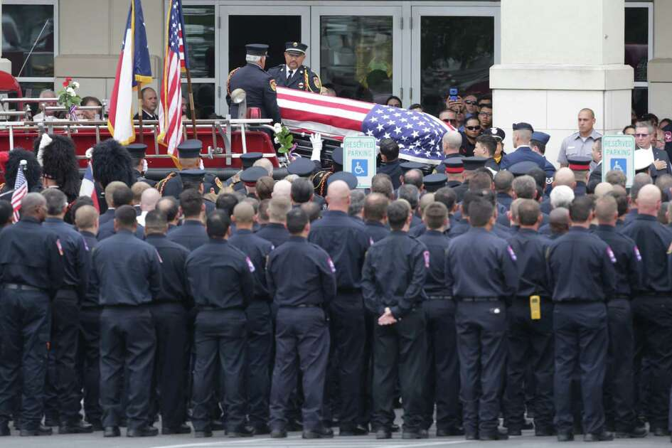 Firefighters salute as the body of a fallen firefighter arrives at Community Bible Church for the funeral for firefighter Scott Deem, who was killed May 18 fighting a blaze in a Northwest Side gym, on Friday, May 26, 2017.