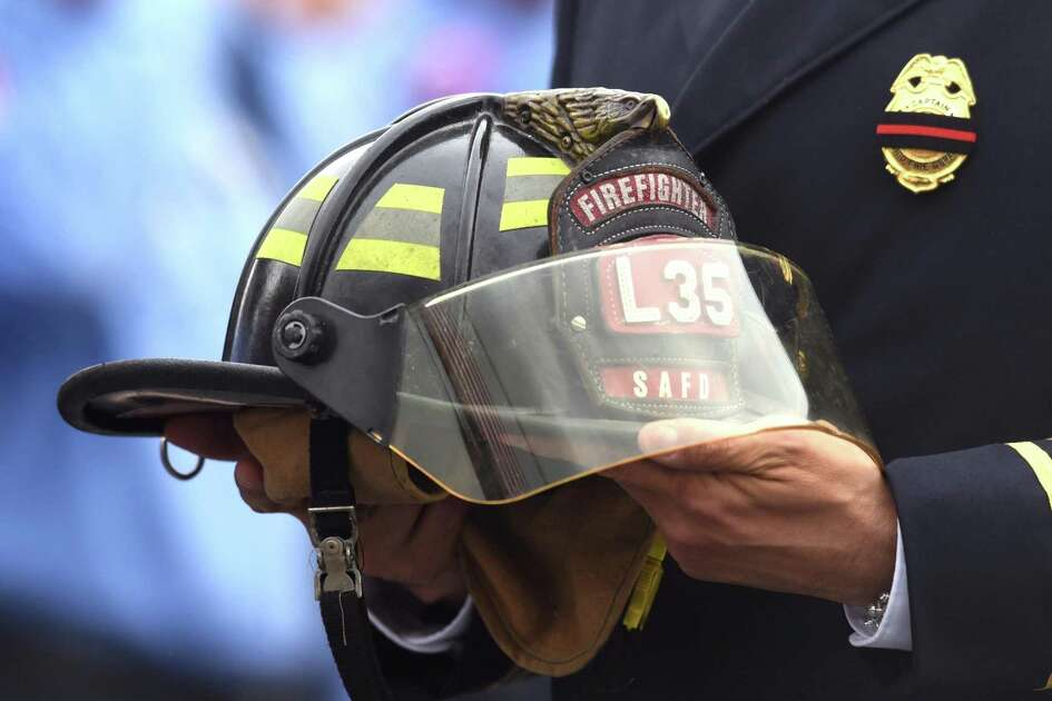 A helmet from Ladder 35 is carried in a procession to Community Bible Church for the funeral service of firefighter Scott Deem on Friday, May 26, 2017. Deem, who was a crewman on Ladder 35, died while fighting a fire at Ingram Square shopping center on May 18.