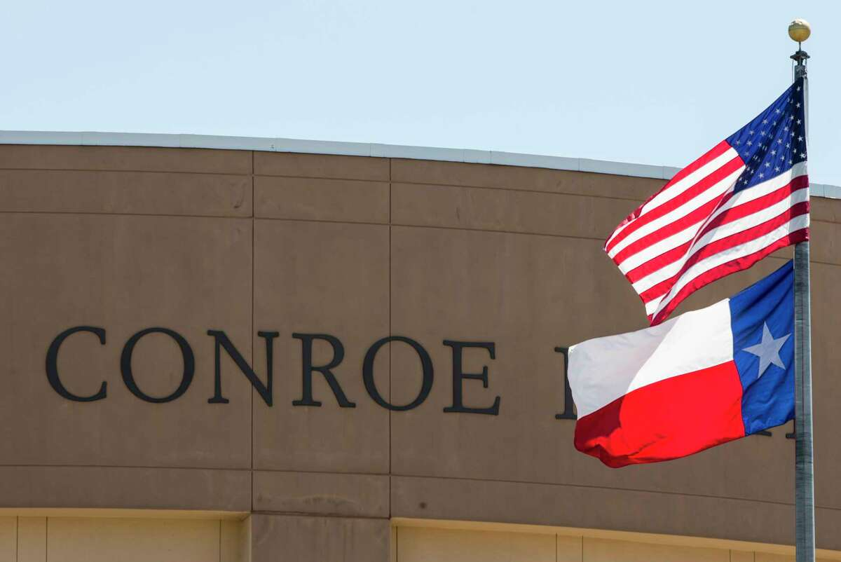 Flags fly in front of Conroe High School on Thursday, May 25, 2017, in Conroe. Between 2015 and 2016, Conroe was the fastest-growing large city (population of 50,000 or more) at 7.8 percent, making its growth rate 11 times the nation's growth rate