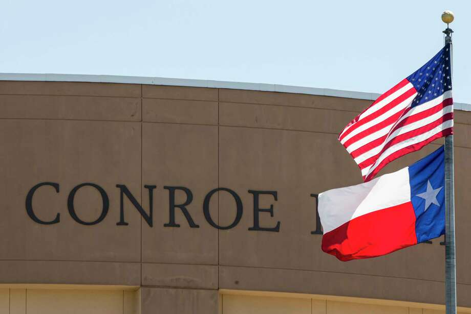 Flags fly in front of Conroe High School on Thursday, May 25, 2017, in Conroe. Between 2015 and 2016, Conroe was the fastest-growing large city (population of 50,000 or more) at 7.8 percent, making its growth rate 11 times the nation's growth rate Photo: Brett Coomer, Houston Chronicle / © 2017 Houston Chronicle