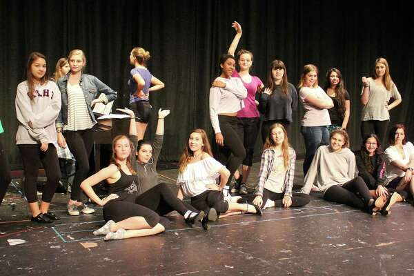"""Students from New Canaan High School rehearse scenes from """"And The World Goes 'Round."""" The show will debut on June 2."""