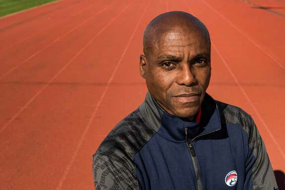 Carl Lewis poses for a portrait at the University of Houston track on Wednesday, Feb. 18, 2015, in Houston. The former UH track star and nine time Olympic gold medalist has joined the Cougars' track and field program as an assistant coach, and will help with sprints and jumps.( Brett Coomer / Houston Chronicle )