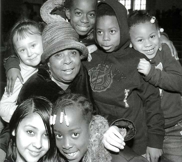 Joyce Hayes surrounded by the children of Glide