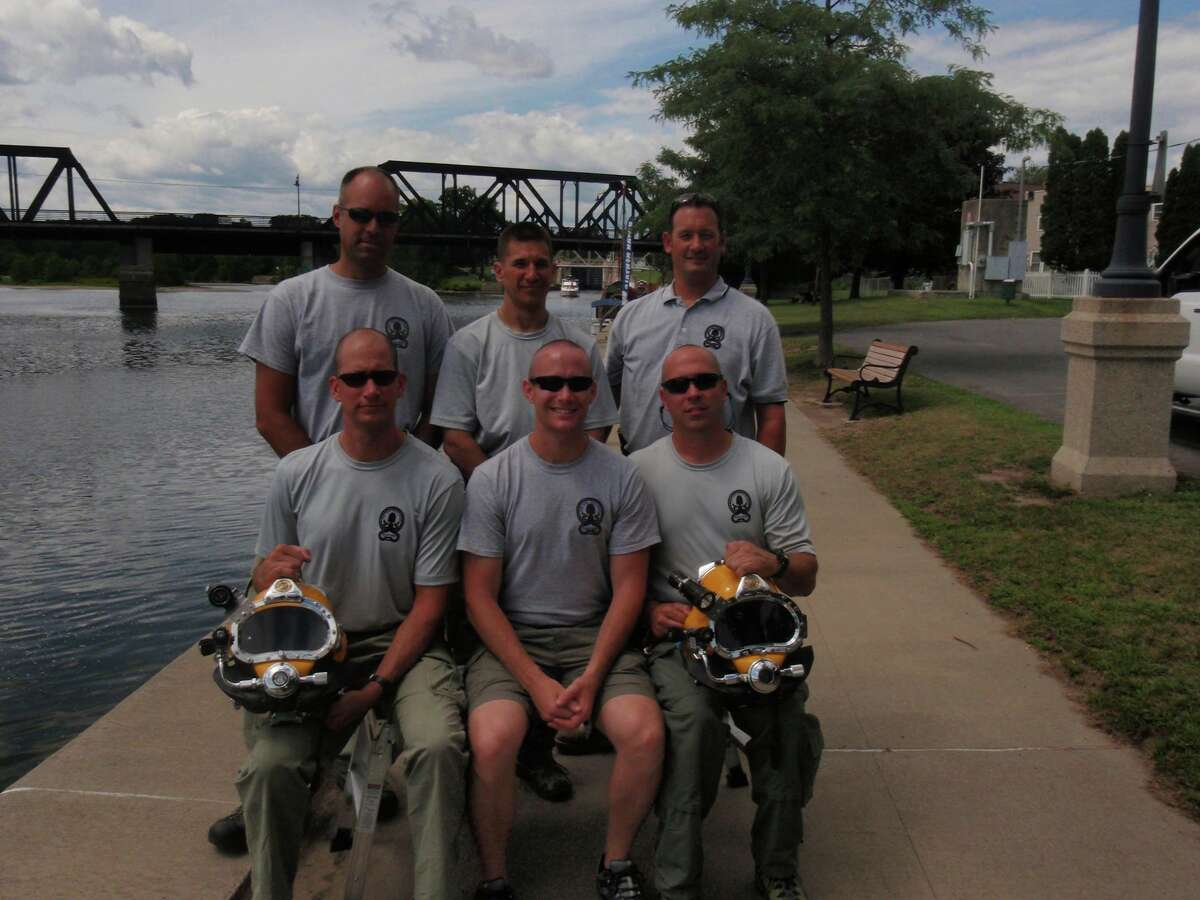 Timothy Hard, back right, poses with other Troop G dive team members on August 10, 2015, after the unit performed several emergency training drills. (State Police)