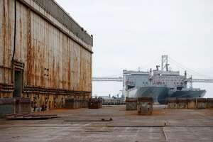 Heavy steel plates are left on the floor of the 800-foot Dry Dock 2 at the former BAE Systems shipyard at Pier 70 in San Francisco, Calif. on Friday, May 26, 2017. The shipyard and dry docks were acquired by Puglia Engineering but backed out of the deal when it claimed there were issues it inherited that were never disclosed.
