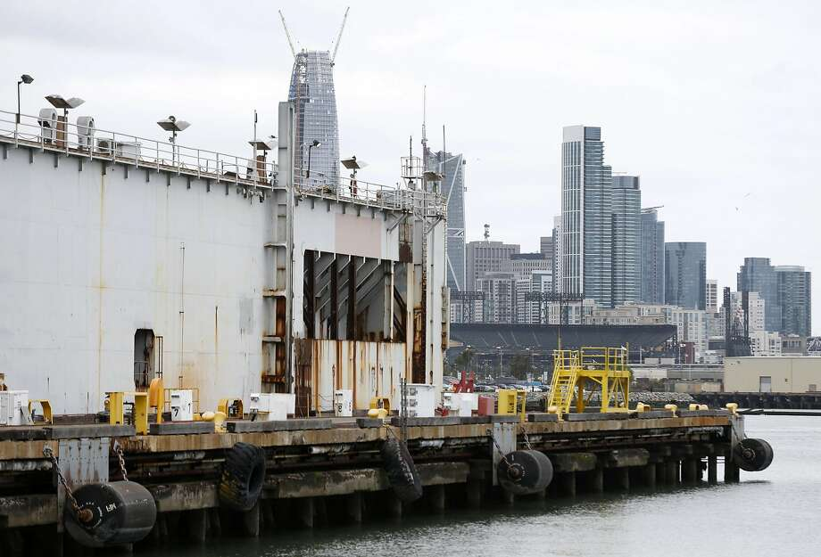 Modern glass towers rise in stark contrast behind the old Eureka dry dock at the former BAE Systems shipyard at Pier 70 in San Francisco. Photo: Paul Chinn, The Chronicle