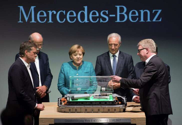 Member of the divisional board of Mercedes-Benz Cars, Markus Schaefer (from left); CEO of German carmaker Daimler and Mercedes-Benz, Dieter Zetsche; German Chancellor Angela Merkel; Saxony State Premier Stanislaw Tillich; an unidentified executive, and director of Deutsche Accumotive GmbH & Co. KG, Frank Blom attend the opening of the new plant of the Accumotive company producing accumulators for cars in Kamenz, eastern Germany on Monday  Accumotive is a subsidary of German car maker Daimler AG.