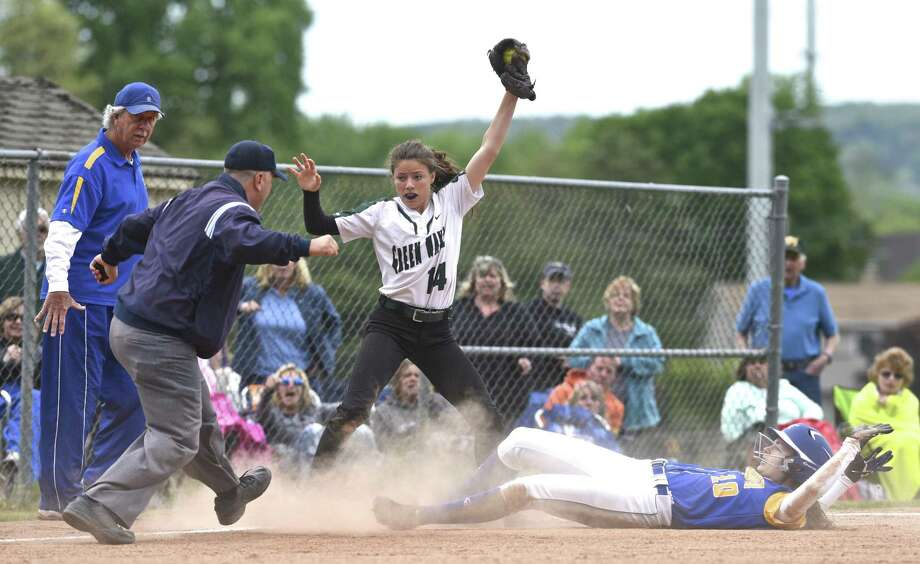 Umpire Austin Hammar calls a play on May 20, 2017, during an SWC softball game between Newtown and New Milford, Conn. Payball, a new app developed in Norwalk, would make it possible for sports leagues to pay youth officials with the tap of a button on a smartphone. Photo: H John Voorhees III / Hearst Connecticut Media / The News-Times