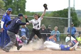Umpire Austin Hammar calls a play on May 20, 2017, during an SWC softball game between Newtown and New Milford, Conn. Payball, a new app developed in Norwalk, would make it possible for sports leagues to pay youth officials with the tap of a button on a smartphone.