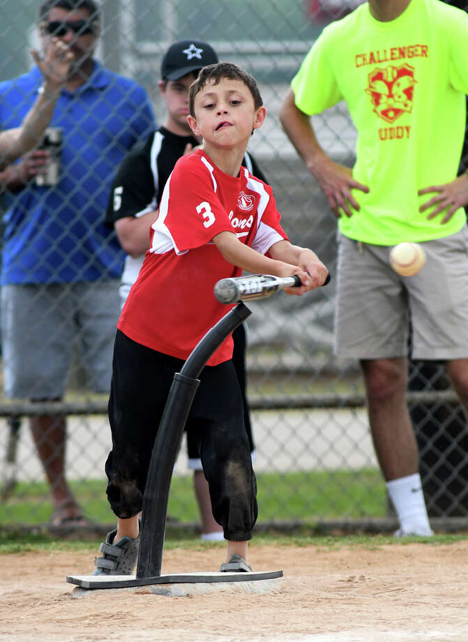 Dylan Angell, 8, works at the plate during final week action of the Huffman Challenger Baseball League, a Little League for children with developmental disabilities, at I.T. May Ballpark in Huffman on May 20, 2017. (Photo by Jerry Baker) Photo: Jerry Baker, Freelance / Freelance