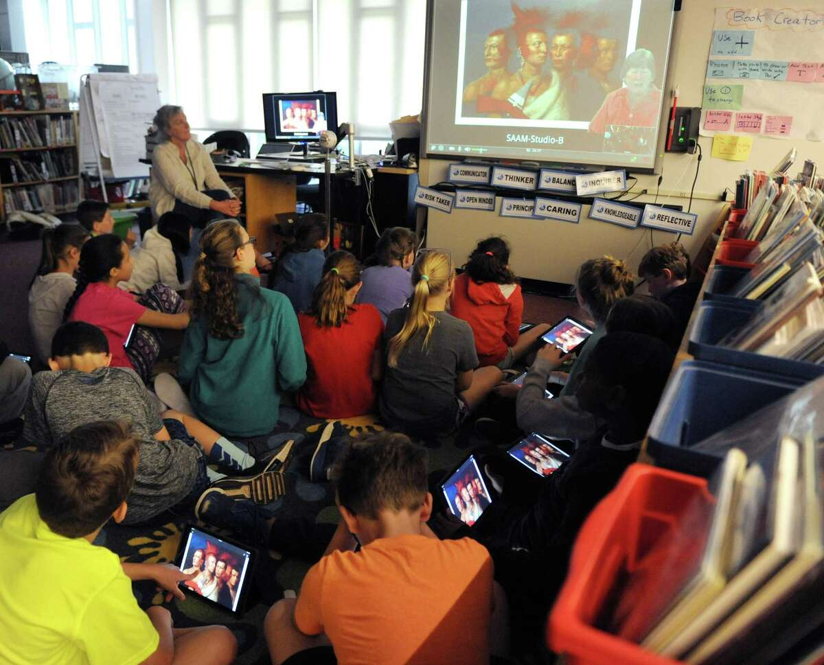 Cindy Williams' fifth-grade class Skypes about American Indians with a representative from the Smithsonian Museum of Art at the International School at Dundee in the Riverside section of Greenwich, Conn. Thursday, May 25, 2017. The class discussed works of art depicting the American Indian culture and history and the influence of geography, tradition, and tribal affiliation on contemporary Indian artists.