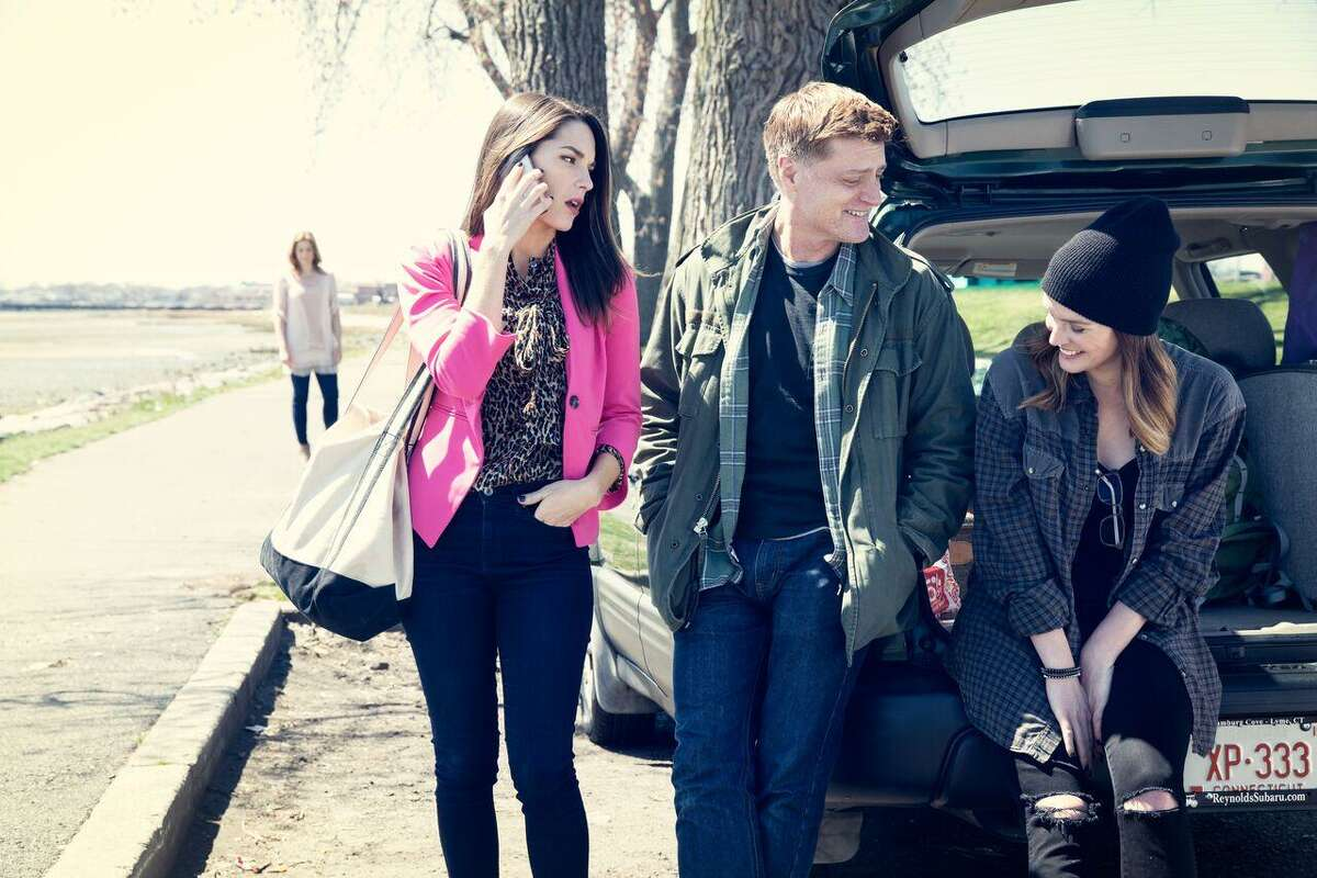 """In """"Deathless,"""" a new musical running June 2 to July 2 in Chester, Dad (Sean Allan Krill), center, takes a break on a long road trip to Niagara Falls, N.Y., with his two daughters (Kelli Barrett, left, and Jennifer Damiano). In background left is the spirit of Mom (Jessica Phillips), who has recently died."""
