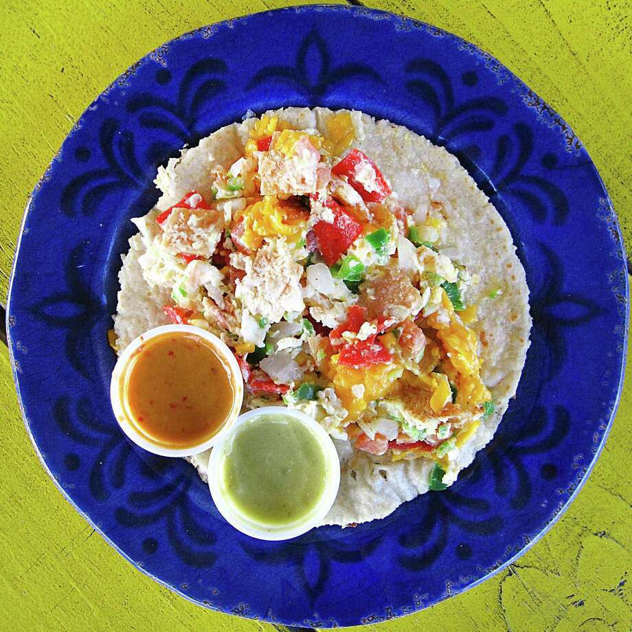 Chilaquiles taco on a handmade corn tortilla from El Itacate Tacos To Go. Photo: Mike Sutter /San Antonio Express-News