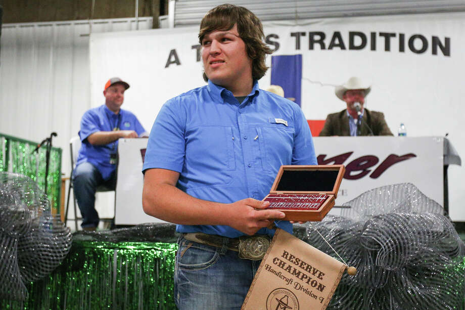 Splendora High School's Tyler Okonski presents his reserve champion Handicraft I entry during the Non-Livestock Auction on Monday, April 3, 2017, at the Montgomery County Fairgrounds. Photo: Michael Minasi, Staff Photographer / © 2017 Houston Chronicle