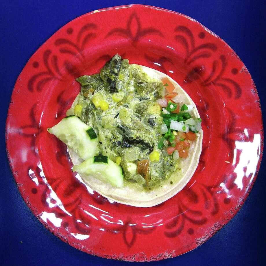 Rajas con queso taco on corn tortillas from La Michoacana Meat Market. Photo: Mike Sutter /San Antonio Express-News