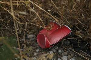 A smashed solo cup lays above Lion Creek, which empties into Damon Slough May 26, 2017 in Oakland, Calif.