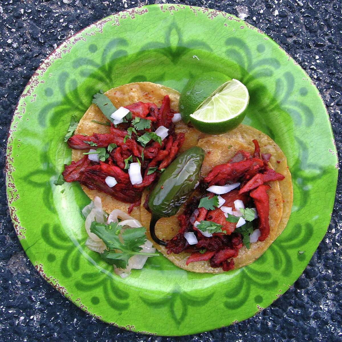 Al pastor mini-tacos on doubled-up corn tortillas from Tacos Beto's.