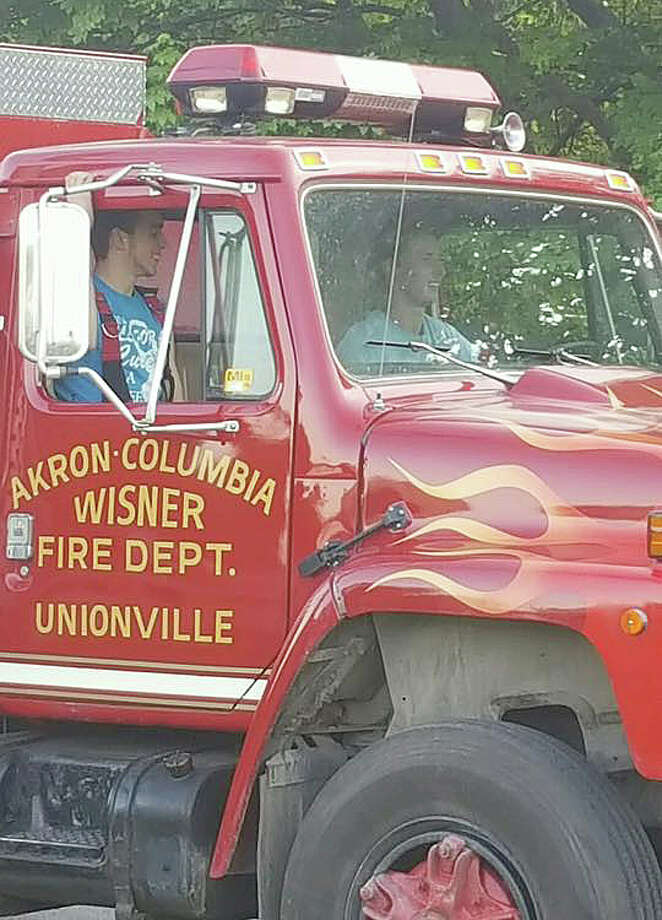 The Unionville-ACW Fire Department made a special delivery to help cover expenses for well-known area law enforcement officer Steven Repkie, who is battling cancer.  Photo: (Submitted Photo)