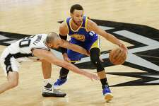 Manu Ginobili of the San Antonio Spurs and Stephen Curry of the Golden State Warriors battle for the ball in the second half during Game Four of the 2017 NBA Western Conference Finals at AT&T Center on May 22. Despite the series loss, the team can be proud of a sterling season.