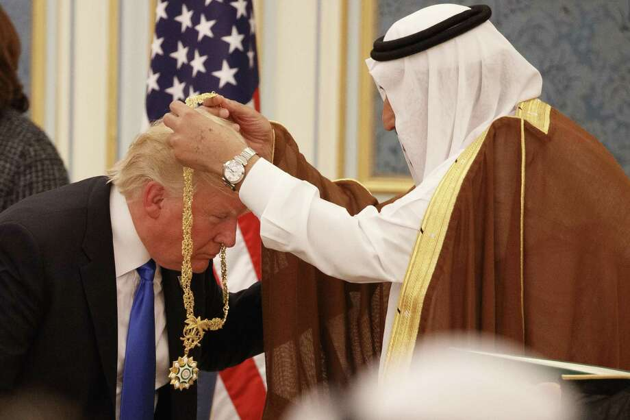 Saudi King Salman presents President Donald Trump with the highest civilian honor the Collar of Abdulaziz Al Saud at the Royal Court Palace on May 20 in Riyadh Saudi Arabia. In his first foreign trip Trump clearly aligned the U.S. with the Sunni Musl