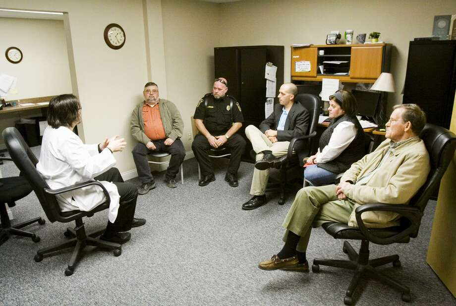 Dr. William Cooke, far left, speaks during a meeting with local and state officials about the recent HIV outbreak in Scott County at Foundations Family Medicine in downtown Austin, Ind., in 2015. Cooke is administering to a community beset by rampant opioid use. Photo: Christopher Fryer /Associated Press / News and Tribune