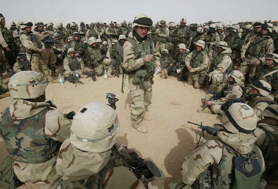 Soldiers from the 3rd Brigade of the 101st Airborne Division are briefed in the Kuwaiti desert on March 21, 2003. We should honor not just those who died in our service, but those who came back. We do that best by holding our leaders accountable for why we go to war in the future. Photo: Associated Press File Photo / AP