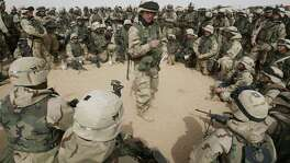 Soldiers from the 3rd Brigade of the 101st Airborne Division are briefed in the Kuwaiti desert on March 21, 2003. We should honor not just those who died in our service, but those who came back. We do that best by holding our leaders accountable for why we go to war in the future.