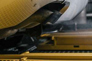 -- PHOTO MOVED IN ADVANCE AND NOT FOR USE - ONLINE OR IN PRINT - BEFORE MAY 7, 2017. -- Exhaust pours out of the tailpipe of a 2006 VW Jetta TDI, on rollers at the Center for Alternative Fuels, Engines and Emissions, at West Virginia University in Morgantown, W.Va., April 10, 2017. A report published in early 2014 by two grad students here set in motion the discovery of Volkswagen�s emissions cheating scandal, but only after the automaker stonewalled for years. (Greg Kahn/The New York Times)
