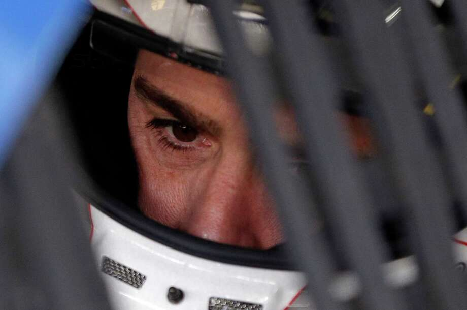Jimmie Johnson looks from his car before practice for Sunday's NASCAR Cup series auto race at Charlotte Motor Speedway in Concord, N.C., Thursday, May 25, 2017. (AP Photo/Chuck Burton) Photo: Chuck Burton, STF / Copyright 2017 The Associated Press. All rights reserved.