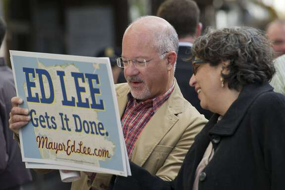 Steve Kawa Ed Lee's chief of staff looks at a sign with Olga Ryerson also a staff member for Ed Lee at the Lee campaign headquarters on Market Street on August 20, 2011 in San Francisco, Calif.  Photograph by David Paul Morris/Special to the Chronicle