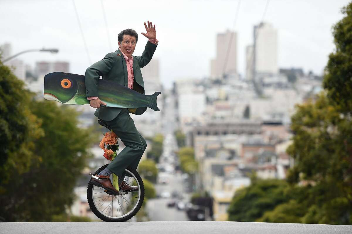 Comedy veteran Michael Meehan rides a unicycle across a street near his home in San Francisco on May 26, 2017. Meehan is the writer, co-star and director of a comedy film which takes place in the city called