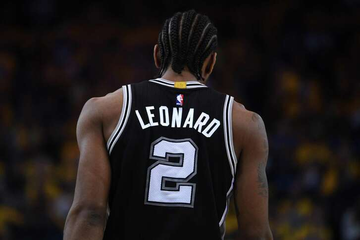 Kawhi Leonard of the Spurs stands on the court during Game1 of the Western Conference finals against the Golden State Warriors at Oracle Arena on May 14, 2017 in Oakland, Calif.