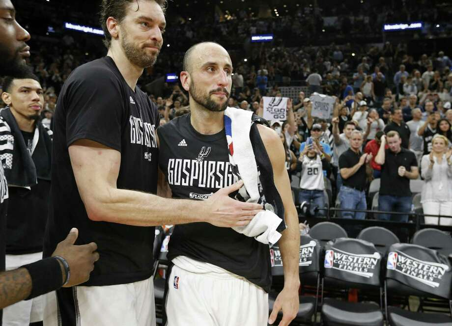 Spurs' Pau Gasol hugs Manu Ginobili after Game 4 of the Western Conference finals against the Golden State Warriors on May 22, 2017 at the AT&T Center. Photo: Edward A. Ornelas /San Antonio Express-News / © 2017 San Antonio Express-News