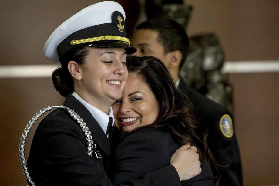 Bridgeport Military Academy relieved Battalion Commander, Evanna Dias, left, hugs Evelyn Gonzalez, wife of a school mentor, U.S. Army Staff Sergent, Carmelo Gonzalez after the Class of 2017 Changing of the Guard and Award Ceremony which took place at the University of Bridgeport on Friday, May 26, 2017. Photo: Johnathon Henninger / For Hearst Connecticut Media / Connecticut Post Freelance