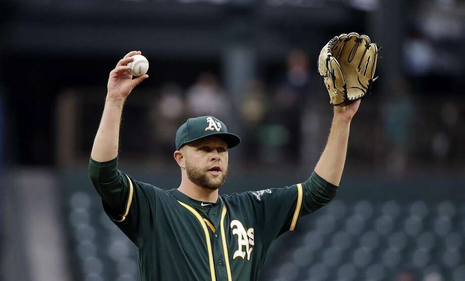 Oakland Athletics starting pitcher Jesse Hahn calls for a new ball against the Seattle Mariners in the first inning of a baseball game Wednesday, May 17, 2017, in Seattle. (AP Photo/Elaine Thompson) Photo: Elaine Thompson, Associated Press