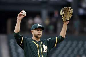 Oakland Athletics starting pitcher Jesse Hahn calls for a new ball against the Seattle Mariners in the first inning of a baseball game Wednesday, May 17, 2017, in Seattle. (AP Photo/Elaine Thompson)