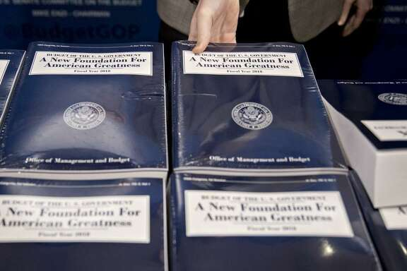 A copy of U.S. President Donald Trump's fiscal 2018 budget proposal. Funding for Medicaid would be cut by more than $800 billion over 10 years. Most safety-net programs would be cut.