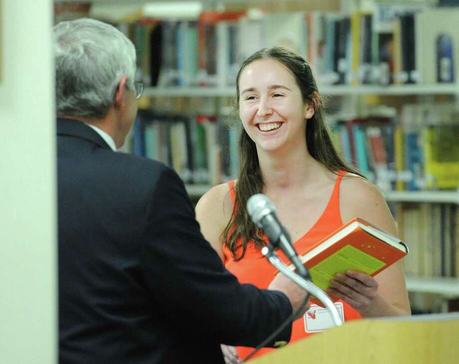At left, Robert Conlan, a science teacher at Greenwich High School, honored Greenwich High School junior and his student Alexandra Braverman during the annual GHS Junior Book Awards ceremony in the media center at Greenwich High School, Conn., Thursday, May 25, 2017. Photo: Bob Luckey Jr. / Hearst Connecticut Media / Greenwich Time