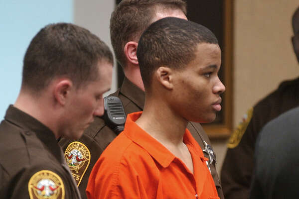** FILE ** Sniper suspect Lee Boyd Malvo listens to court proceedings during the trial of fellow sniper suspect John Allen Muhammad in Virginia Beach, Va., Monday, Oct. 20, 2003. The lawyer for convicted teenage sniper Malvo says his client plans to drop all appeals of his conviction and life sentence for one of 10 sniper killings in October 2002 and admit his guilt in a second slaying. (AP Photo/Martin Smith-Rodden, Pool)