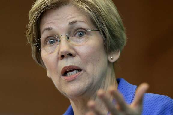 FILE- In this March 27, 2017, file photo, U.S. Sen. ElizabethWarren, D-Mass., addresses business leaders during a New England Council luncheon in Boston. Warren is slated to deliver the commencement address at Boston's Wheelock College on Friday, May 19. (AP Photo/Steven Senne, File)