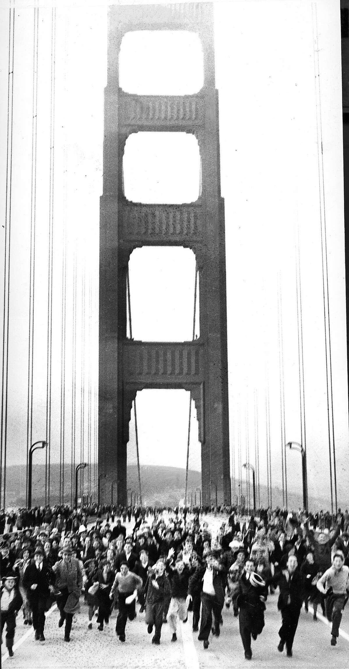 running across the Golden Gate Bridge on opening day, May 27, 1937