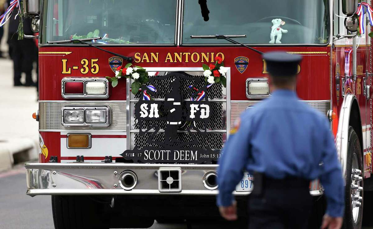 A firefighter walks by the truck that San Antonio Firefighter Scott Deem worked on, at the funeral for Deem at Community Bible Church on Friday, May 26, 2017.