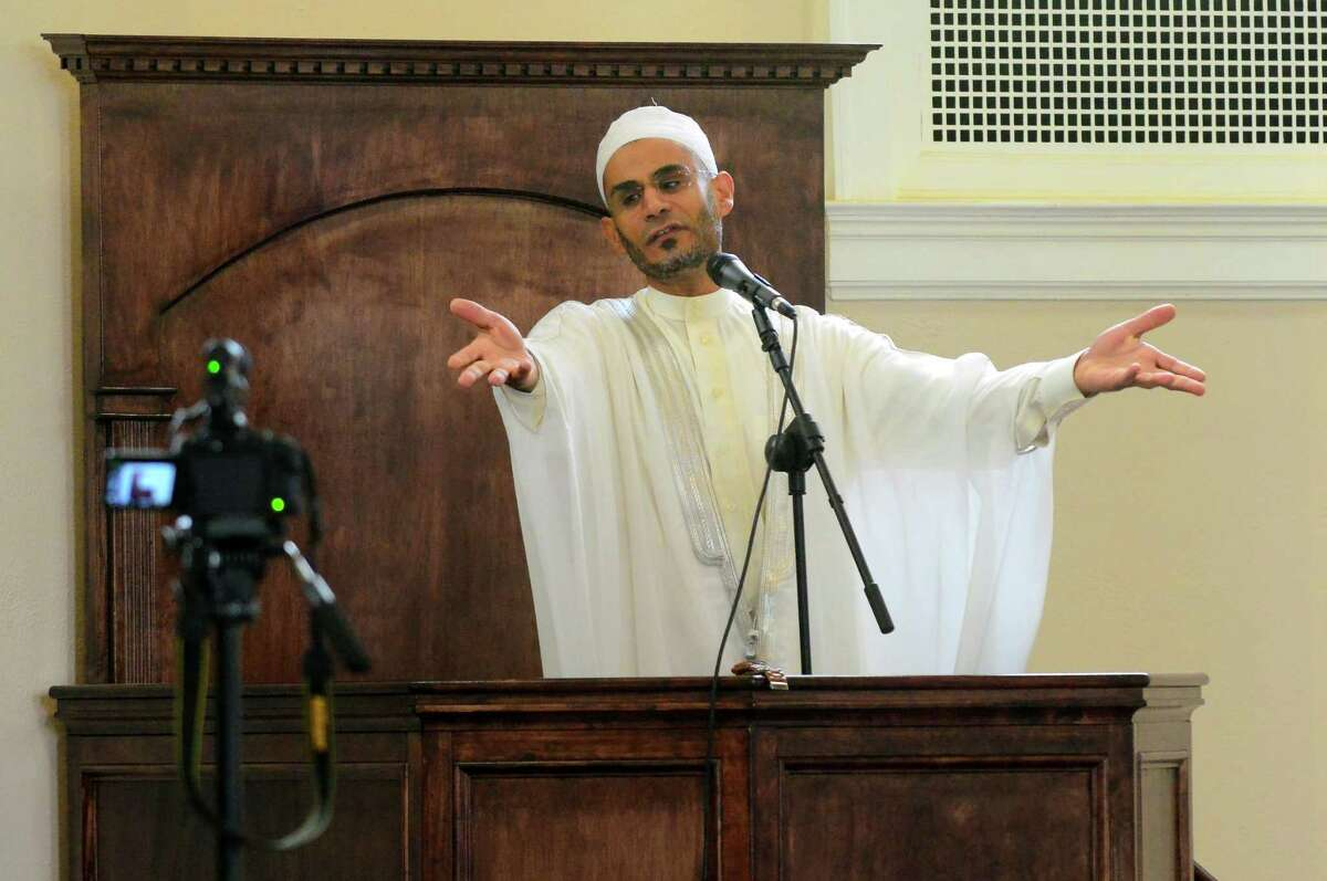 Sheikh Mohamed Abdelati delivers the Khutbah, or sermon, at the new Bridgeport Islamic Community Center's Friday prayers held at the former United Congregational Church in Bridgeport, Conn., on Friday May 26, 2017.