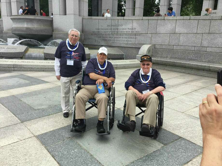 Dr. Peter Arturi, Lou Caravella and Charles Marshall, veterans from Greenwich, take in the sights at the World War II Memorial in Washington, D.C. Photo: / Contributed: Randy Caravella