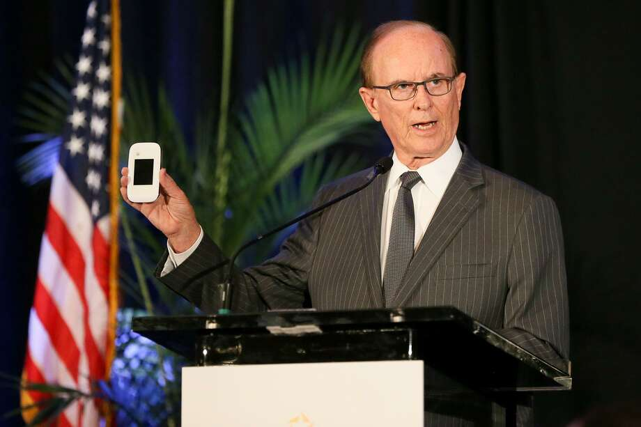 """County Judge Nelson Wolff holds a Sprint Pocket Wi-Fi, one of 150 that will be available to be checked out at the Bexar County BiblioTech, while giving his annual """"State of the County"""" address, hosted by the North San Antonio Chamber of Commerce, at the Omni San Antonio Hotel at the Colonnade on Friday, May 26, 2017.  MARVIN PFEIFFER/ mpfeiffer@express-news.net Photo: Marvin Pfeiffer, Staff / San Antonio Express-News / Express-News 2017"""