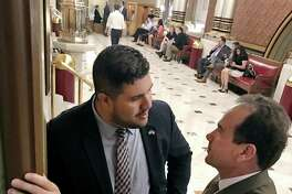 State Rep. Chris Rosario, D-Bridgeport, left, with Bridgeport Mayor Joe Ganim as they discuss pension legislation at the Capitol in Hartford, Conn. on Thursday, May 25, 2017.