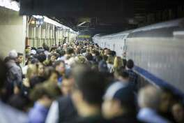Passengers crowd a platform waiting for a train to Stamford. A plan to bring Amtrak and Long Island Railroad trains to Grand Central Terminal is raising concerns in Connecticut over whether the increased congestion will impact the millions of Metro-North commuters already using the famed station.