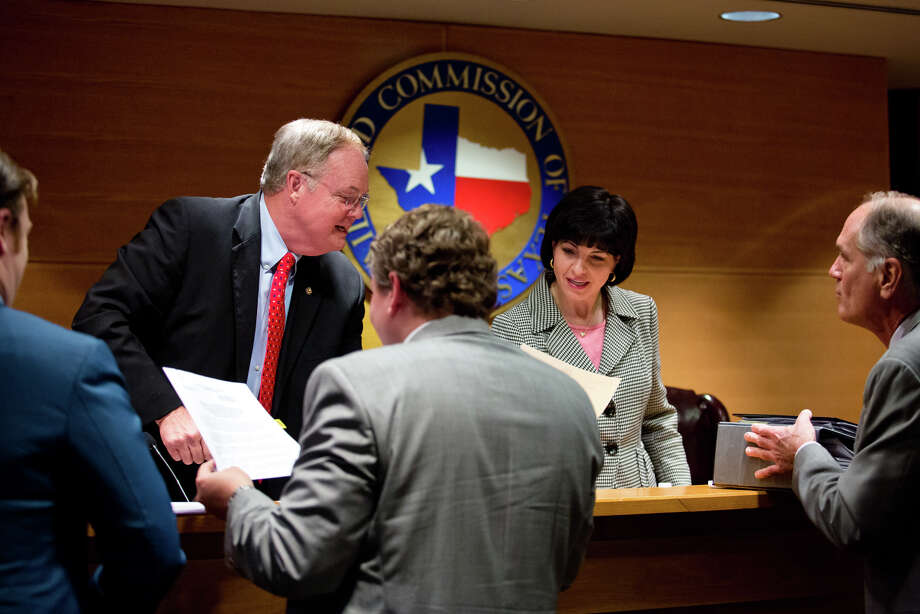 Commissioner Wayne Christian and Chairman Christi Craddick sign orders after a Texas Railroad Commission conference this month. Women occupy eight of the 15 top leadership positions - excluding the three elected commissioners - at the commission.  Photo: Callie Richmond / Houston Chronicle