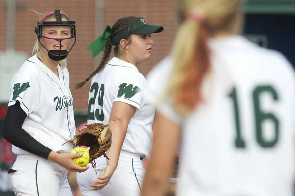 The Woodlands starting pitcher Emily Langkamp yells toward third baseman Skylar Sirdashney after Sirdashney's 2-run error during the sixth inning gave Bowie a 2-1 lead in Game 1 of a Region II-6A final high school softball series at the Mumford Athletic Complex, Friday, May 26, 2017, in Mumford.