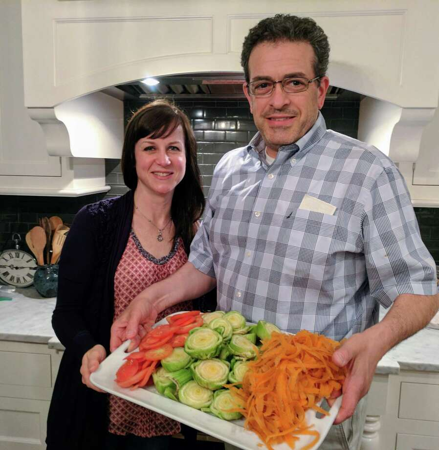 "Thomas and Meg McQuillan in the kitchen of their Riverside home with a platter of what McQuillan has coined ""SparCs"" — what used to be the 150,000 pounds of edible but unattractive food Baldor Specialty Foods was discarding each week before he created the program resulting in zero waste. Photo: Jennifer Turiano / Hearst Media"